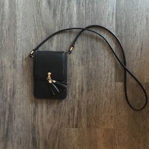 Wallet/bag with cell phone case and strap.